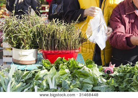 Selling organic vegetables on market