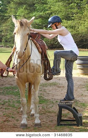 young woman mounting horse Stock Photo & Stock Images | Bigstock