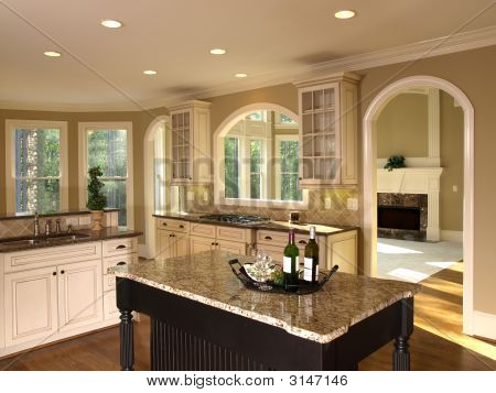 Luxury model home kitchen island stock photo stock for Model kitchen photo