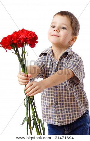 Smiling boy stretches forward a bouquet