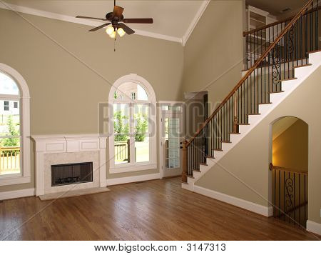 Luxury Model Home Living Room Fireplace And Staircase