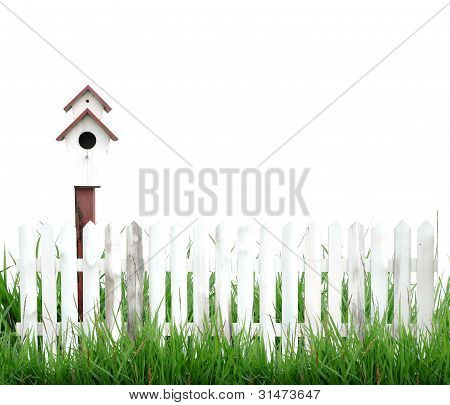 bird house and white fence isolated on white background
