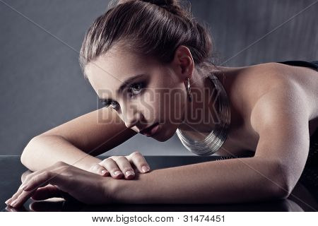 brunette woman with jewellery, toned
