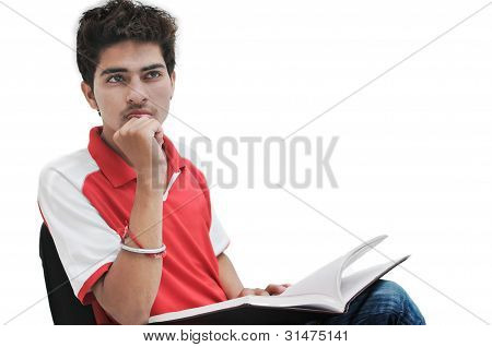 Indian student studying in classroom.