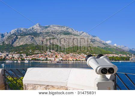 Binoculars And Makarska At Croatia