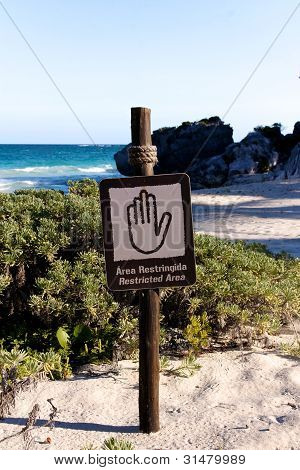 Bilingual Spanish English Sign Restricted Area At Beach Portrait