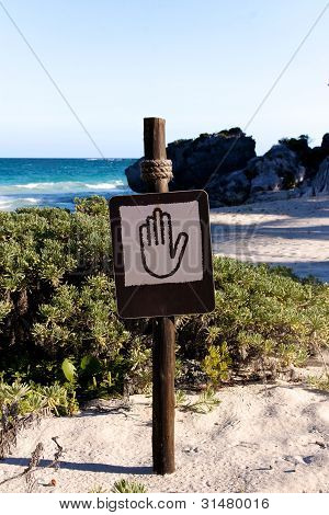 Sign With A Hand Pictogram At A Beach Portrait