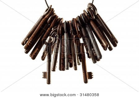 Old Keys Against White Background