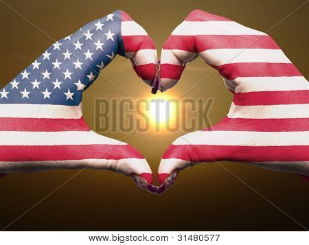Heart And Love Gesture By Hands Colored In Usa Flag During Beautiful Sunrise For Tourism