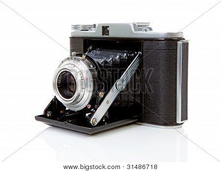 Old Fashioned Photo Camera On White