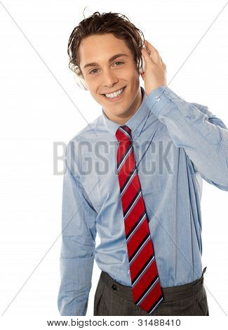 Relaxed Young Smiling Male Listening To Music