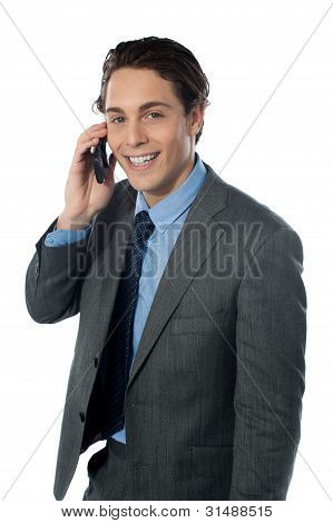 Portrait Of A Smiling Businessman Using A Cellphone