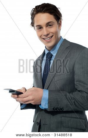 Handsome Young Man Navigating On His Smartphone