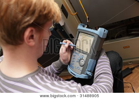 Engineer Setting Reflectometer