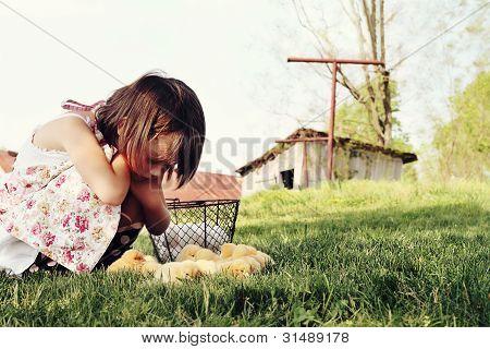 Child Watching Chicks