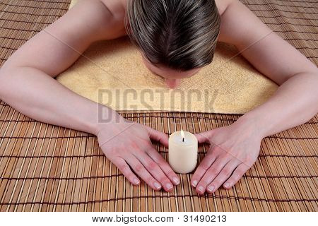Woman On Bamboo With Heart And Candle