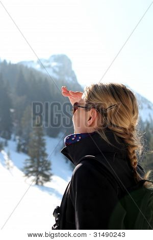 Woman Looking Up On A Mountain