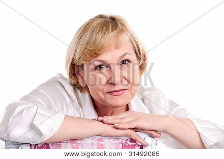 Cheerful mature woman over white background