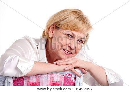 Smiling mature woman over white background