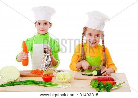 Two girls make a salad