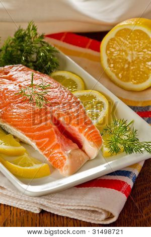 Fresh salmon steak with lemon slices