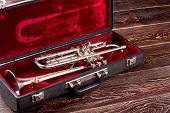 Professional Trumpet In Velvet Case. Brass Lacquered Trumpet. Classical Jazzy Instrument. poster