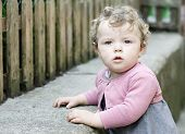 picture of cute little girl  - Little girl looking at camera portrayed with a closeup - JPG
