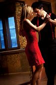 foto of tango  - A man and a woman in the most romantic dance - JPG