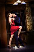stock photo of tango  - A man and a woman dancing tango - JPG
