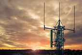 Telecommunications Tower, 5g Antenna And Satellite Dish On The Background Of A Cloudy Sky At Sunset  poster