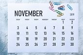 Simple 2019 November Monthly Calendar On Table With Office Supplies poster