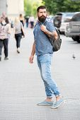 Hipster Wearing Backpack Urban Street Background. Bearded Man Travel With Backpack. Guy Exploring Ci poster
