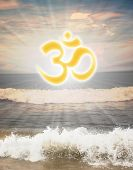 stock photo of ohm  - Hindu religious symbol om or aum against sun shine in the background and waves from the ocean in the foreground - JPG
