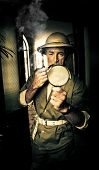 stock photo of olden days  - Olden day explorer in vintage clothing smoking a pipe and holding a magnifying glass walking along the halls of discovery and adventure - JPG