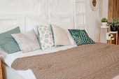 Green, Beige Pillow On Bed In Bedroom With Pastel Colored Bedsheets On Bed. Stylish White Apartment  poster