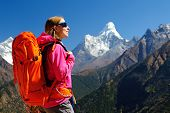 Hiking In Himalaya Mountains. Woman Traveler With Backpack Hiking In The Mountains. Mountaineering S poster