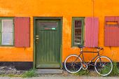Picturesque Of Copenhagen. Old Yellow House Of Nyboder District With Bike. Old Medieval District In  poster
