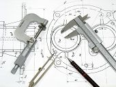 stock photo of micrometer  - Engineering tools on technical drawing - JPG