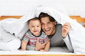 Boys Are Boys. Cheerful Baby Hiding Under Blanket With Father, Empty Space poster