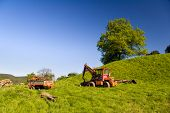 foto of feedlot  - agriculture farming Landscape with Tractor in Summer - JPG