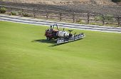Sprayer Machine Performing Maintenance At Golf Course. Shelf Propelled Vehicle poster