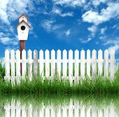 picture of bird fence  - white fence with bird house and blue sky - JPG