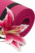 picture of yoga mat  - Yoga mat and a beautiful lily on white background - JPG