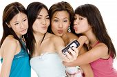 pic of foursome  - four attractive young women pucker - JPG