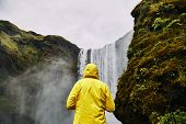 Beautiful Scenery Of The Majestic Skogafoss Waterfall In Countryside Of Iceland In Summer. A Girl In poster