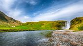 Beautiful Scenery Of The Majestic Skogafoss Waterfall In Countryside Of Iceland In Summer. Location: poster