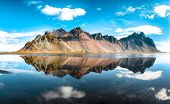 Splendid Sunny Day And Gorgeous Reflection Of Vestrahorn Mountaine On Stokksnes Cape In Iceland. Loc poster