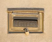 Retro Mailbox Wall Mounted On Yellow Plaster Wall Background. Copper Postbox For Letters Closed On L poster
