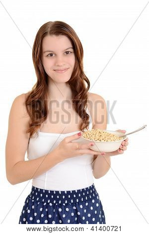 Teen girl holding bowl of cereal