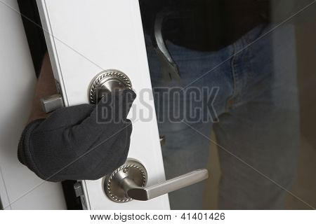 Close up of robber's hand closing door after robbery